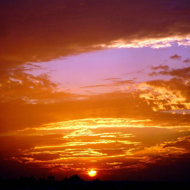 #sunset at #campliberty. Definitely spectacular due to the tons of garbage we were burning in the dumps. -_-. Took this on my old Sony point and shoot.  #photography #amateurphotography #photographer #amateurphotographer #naturephotography #nature #scenery #sun #skyonfire